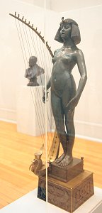 The Singer by Edward Onslow Ford - front left in glass case